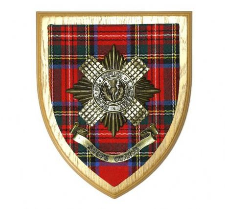 Metallic brass finished Scots Guards cap badge set against the regimental tartan on a solid wooden plaque. The Scots Guards wall plaque.